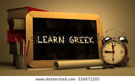 Hand Drawn Learn Greek Concept  on Chalkboard. Blurred Background. Toned Image. - stock photo