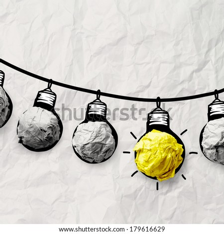hand drawn light bulb on wire doodle with crumpled paper as leadership idea concept - stock photo