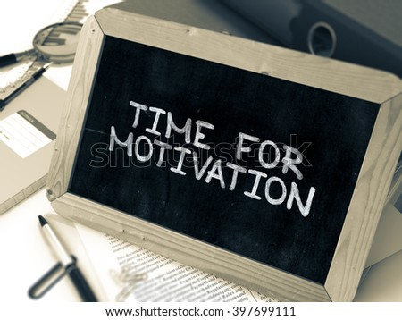 Hand Drawn Time for Motivation Concept  on Chalkboard. Blurred Background. Toned Image. 3D Render. - stock photo