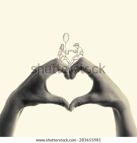 hand-drawn woman with a guy sitting on a heart made up of hand - stock photo