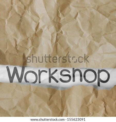 hand drawn workshop words on crumpled paper with tear envelope as concept - stock photo