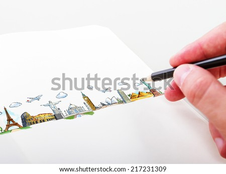 hand drawning travel landmarks in a paper - stock photo