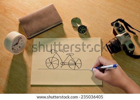 Hand draws a bicycle - stock photo