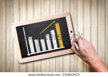 hand draws a diagram on a blackboard - stock photo