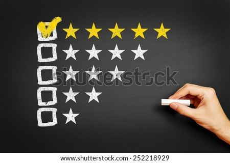 Hand draws concept for feedback with five stars on blackboard - stock photo