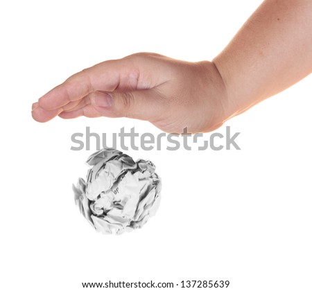 Hand drop crumple paper waste ball isolated on white background