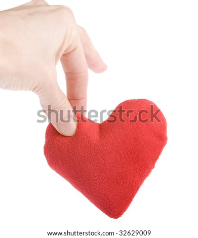 Hand dropping heart shot on white background - stock photo