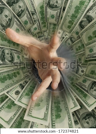 hand drowning in money hole (Shallow DOF) - stock photo