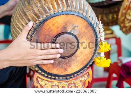 Hand drumming ancient Thailand in brand - stock photo