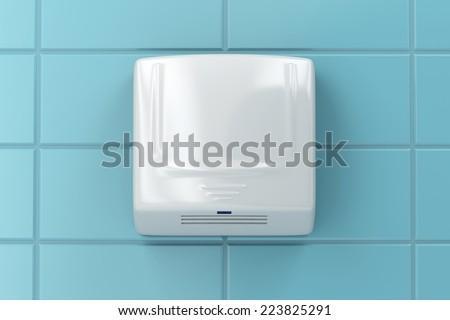 Hand dryer in public toilet - stock photo