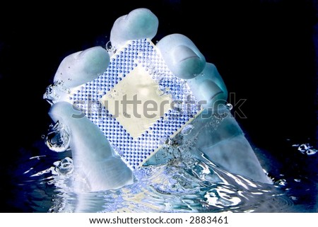 Hand emerging from water surface, with drops around holding a cpu (processor) - like I Got It :) - stock photo