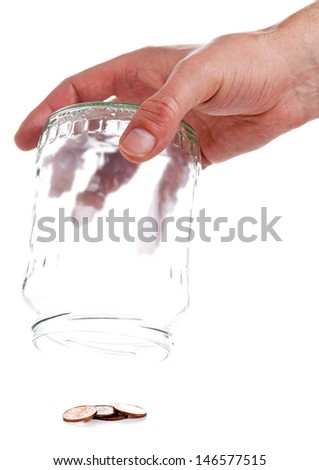Hand emptying penny jar with last pennies over white background