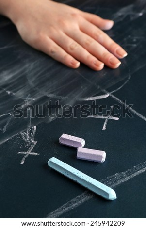 Hand erased scheme football game from blackboard background - stock photo