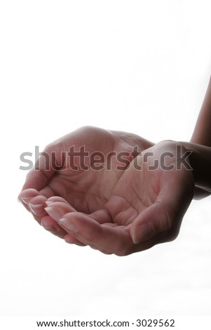 Hand extended in a cupped gesture - stock photo