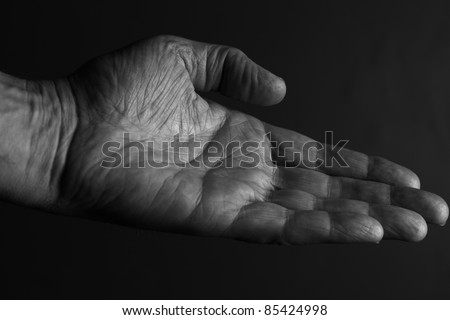 Hand extended to offer or receive something - stock photo