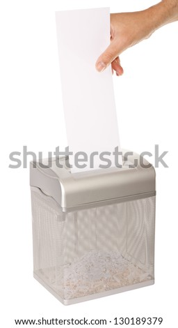 Hand feeding a piece of paper into a document shredder - room for copy. Isolated on white with clipping path. - stock photo