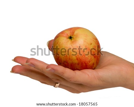 Hand female with an apple on a palm