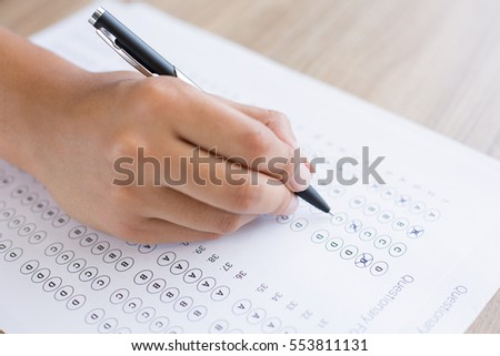 Hand Filling out Quiz Form