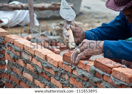 hand for construction for wall - stock photo
