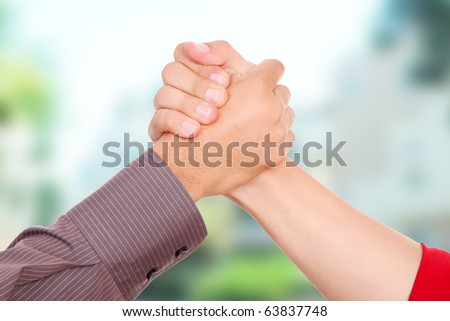 Hand friendly greeting in an outdoor urban scene - stock photo