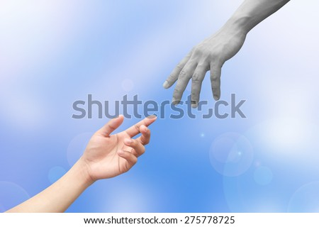 hand from heaven reaching human hands , hands reaching each others, - stock photo