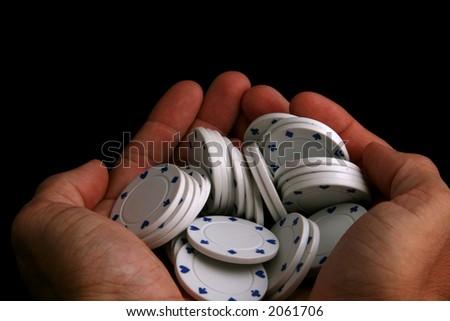 hand full of poker chips - stock photo