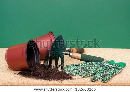 Hand garden tools with flower pot - stock photo