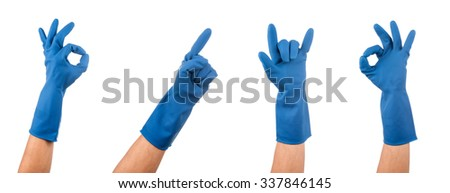 Hand gestures in blue rubber glove - stock photo