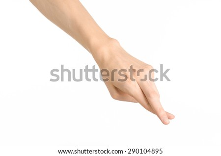 Hand gestures theme: the human hand shows gestures isolated on white background in studio - stock photo