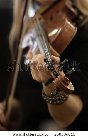 Hand girl playing the violin - stock photo