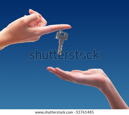 hand gives a key