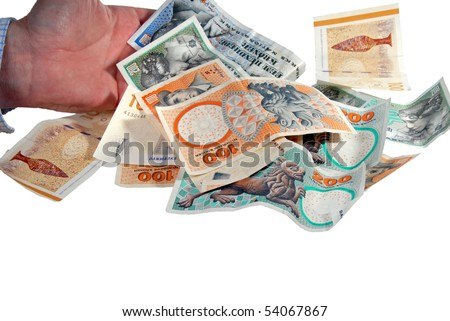 Hand giving a pile of Danish money - stock photo