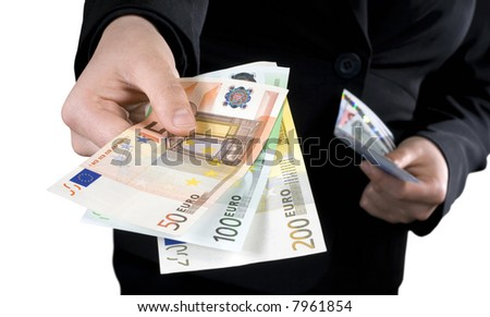 Hand giving Euro banknotes of 50, 100 and 200 Euro with another hand in the background keeping the spare. Isolated. Studio shot.