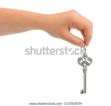 Hand giving key isolated on white background - stock photo