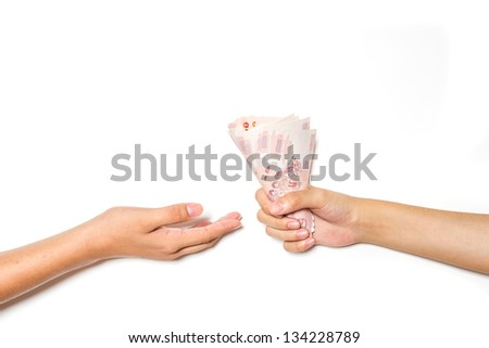 Hand giving money on white background - stock photo