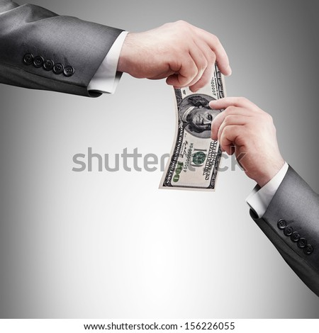 Hand giving money to other hand. High resolution  - stock photo