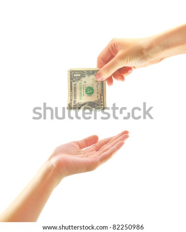 Hand giving money to other hand isolated - stock photo