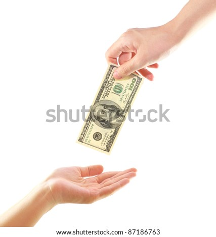 Hand giving money to other hand isolated  on white - stock photo