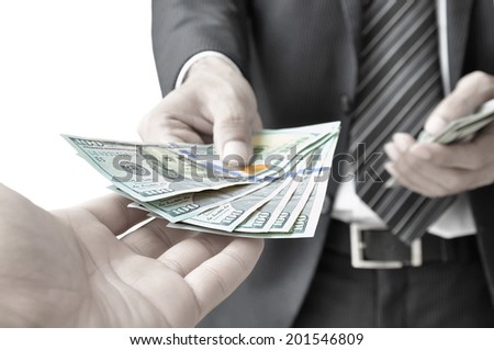 Hand giving money - United States Dollars (or USD) - stock photo