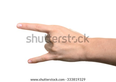 Hand giving the devil horns gesture on a white isolated background - stock photo