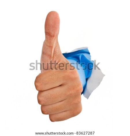 Hand giving thumbs up from a ripped hole in a white paper background - stock photo