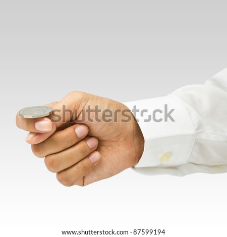 Hand going to play head or tail - stock photo