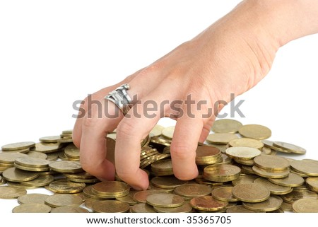 Hand grabbing coins from the pile isolated on the white background