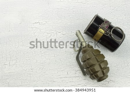 Hand grenade on shadowed, cracked background. War game. Sales of weapons. - stock photo