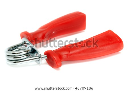 Hand grippers with red handles isolated on white. - stock photo