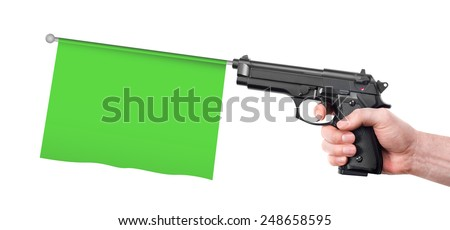 Hand gun with flag - stock photo