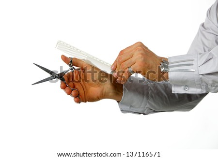 Hand hairdresser with work tools, isolated on white - stock photo
