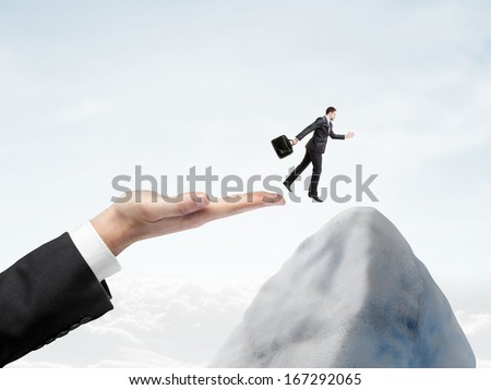 hand halped to jump to businessman - stock photo