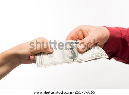 Hand handing over money - stock photo