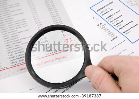 Hand held Magnifying Lens magnifying Bank and credit card Statements